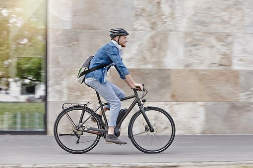 man on bicycle  with helmet
